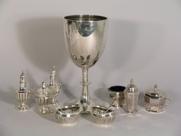 21B: A selection of silver to include; a silver goblet,