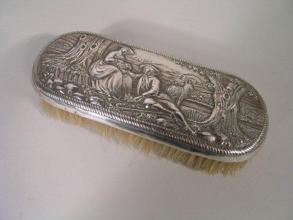 23B: A George III silver backed brush, London 1807, emb