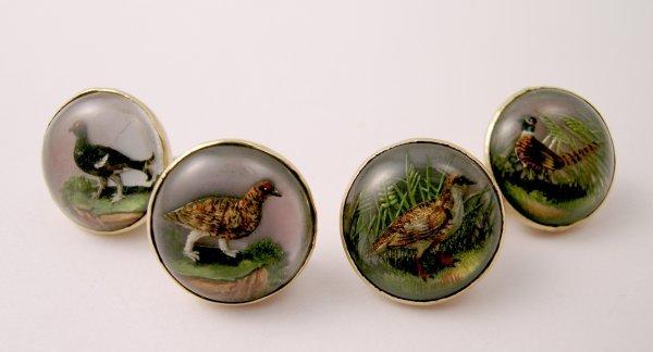 125B: A pair of intaglio set cufflinks depicting game b