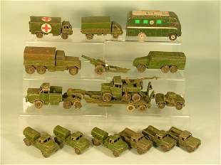 A group of Dinky army unboxed vehicles from the 19
