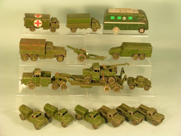 13C: A group of Dinky army unboxed vehicles from the 19