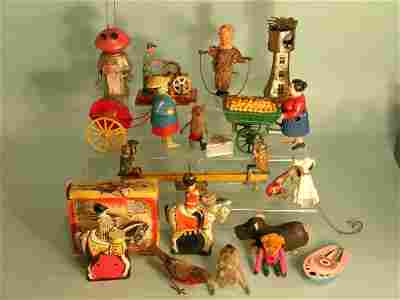 162C: A group of novelty figures in tinplate, cloth and