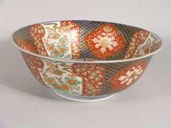 1D: A Japanese brocade imari bowl, circa 1900, busily d