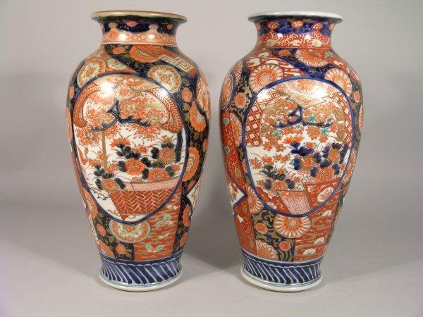2D: A near matching pair of Japanese imari baluster vas