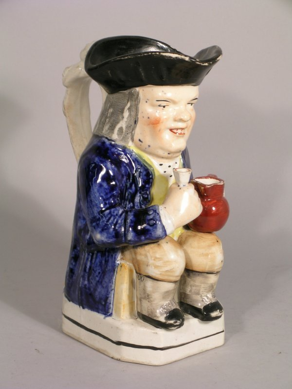 16D: A Staffordshire toby jug, 19th century, modelled s
