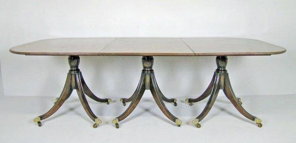 171D: A tri-pillar dining table, 20th century, mahogany