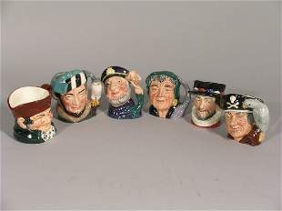 A collection of six Royal Doulton character jugs to