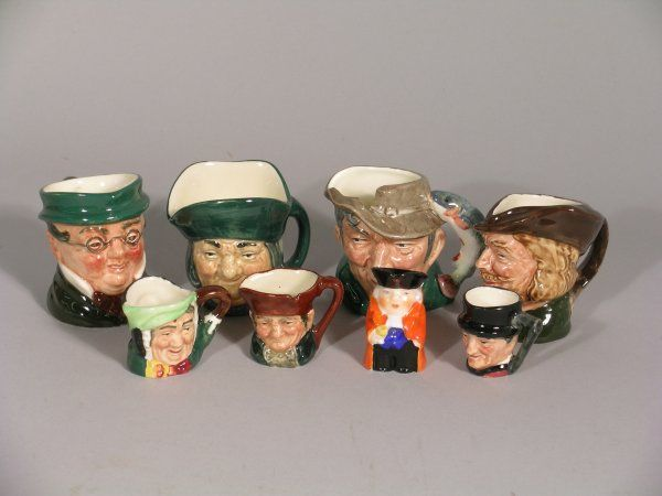 A collection of seven Royal Doulton character jugs,