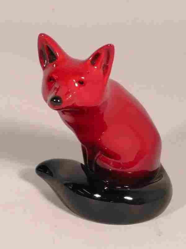 A Royal Doulton flambe fox, the animal modelled sea