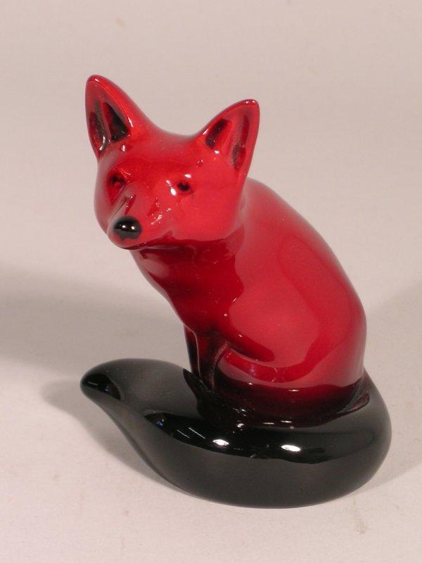 8B: A Royal Doulton flambe fox, the animal modelled sea