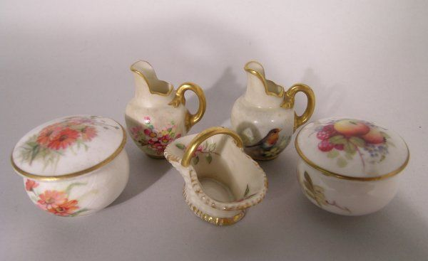 A selection of miniature Royal Worcester wares, to