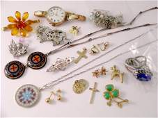 67B: A collection of various gold and silver jewellery,