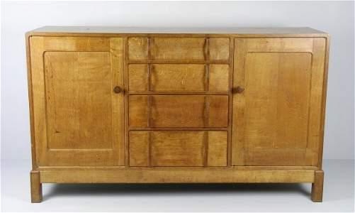 323B: A sideboard, 1950s / 60s, oak, the sideboard of r