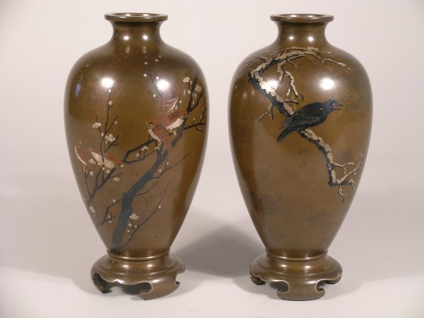 12C: A pair of Japanese bronze and inlaid ovoid vases o