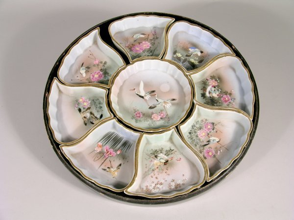 19C: A Japanese porcelain hors d'oeuvres set, early 20t