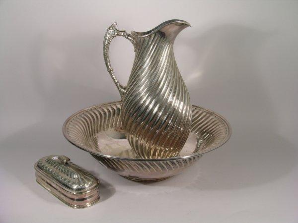 1B: A silver plated toilet set, comprising a wrythen mo