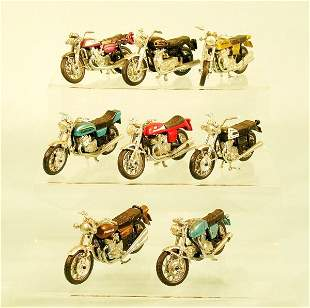 A collection of eleven motorcycles, unboxed and dat