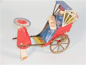 181D: A pre-war model of a Rickshaw with passenger by B