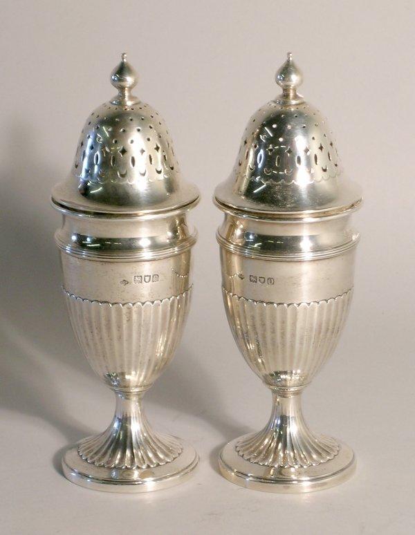 2C: A near pair of silver sugar casters, London 1909 an