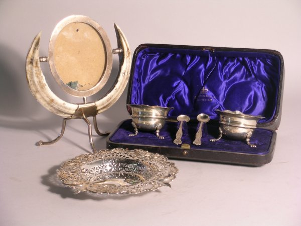 4C: A selection of silver items to include; an oval pho