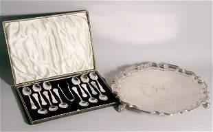 A cased set of twelve silver tea spoons and sugar n