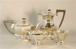 A four piece silver tea service, Walker and Hall S