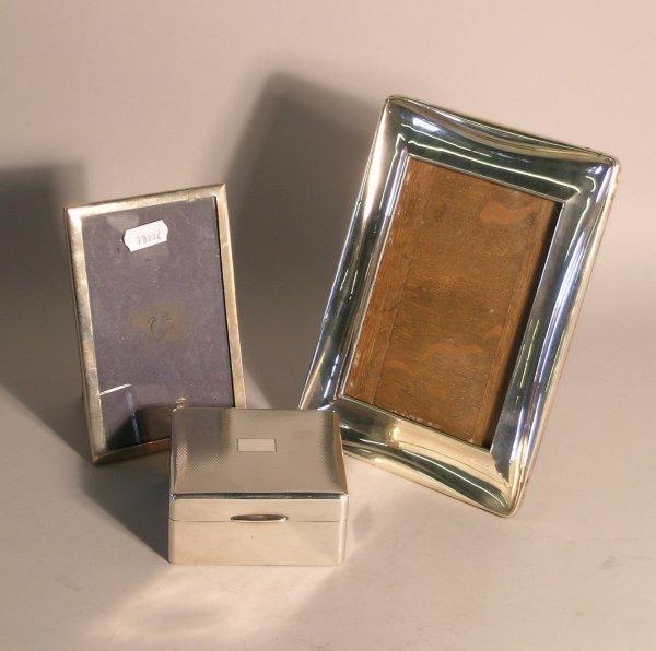 18C: A silver mounted cigarette box, Birmingham 1927, w