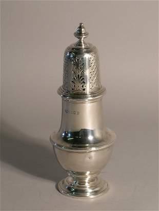 A silver sugar caster Goldsmiths and Silversmiths