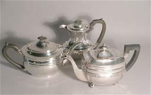 Two silver teapots, to include an oblong, reeded t