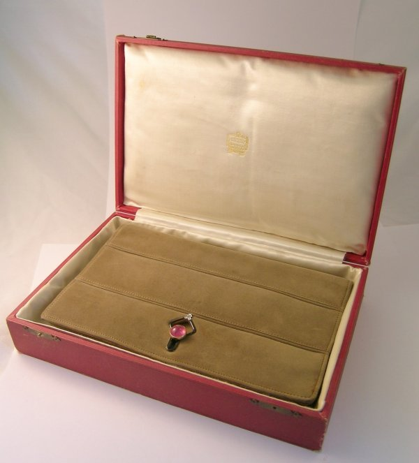 34C: A lady's Cartier clutch bag, within case, 1930's,