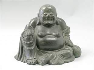A Chinese bronze figure of Hotei, the corpulent sea