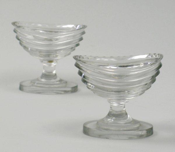10B: A pair of slice cut navette shape pedestal glass s