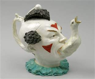 A pottery tea pot, 19th century,