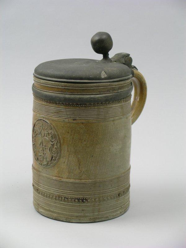 15B: A German salt glazed stoneware pewter mounted krug