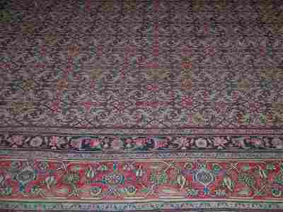 185B: A large cream ground Persian carpet, possibly Kir