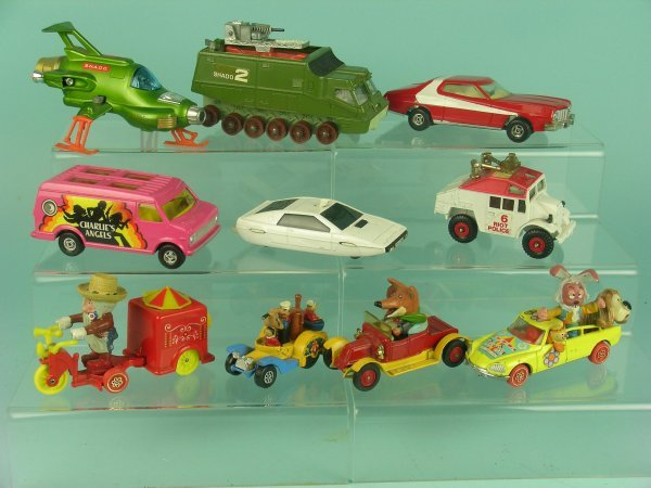 13B: A group of ten unboxed character toy vehicles, ite