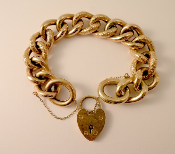2C: A 9ct yellow gold curb link bracelet, the uniform l