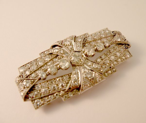 3C: An Art Deco diamond set brooch, the oblong panel br