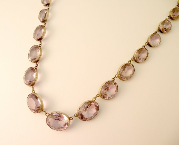 6C: An amethyst necklace, the twenty one oval amethysts