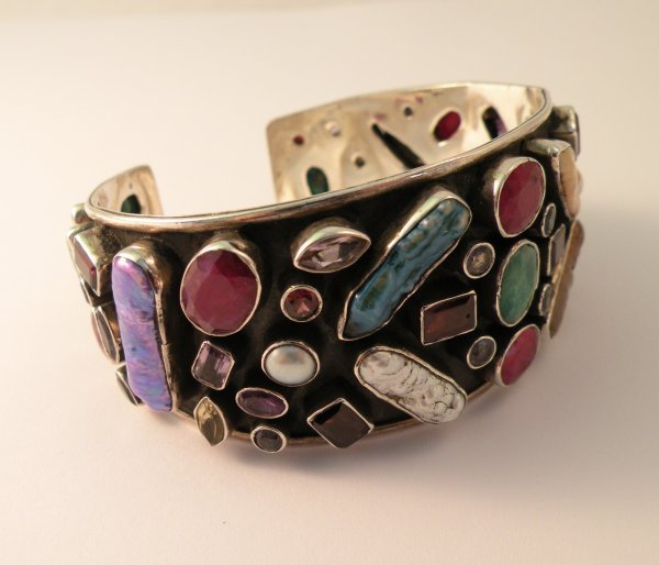 10C: A multi gem set bangle, the white metal bangle, co