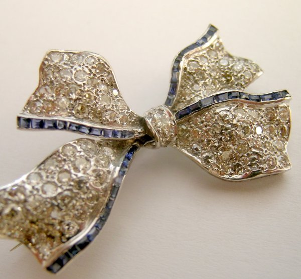 11C: A sapphire and diamond bow brooch, the ribbon bow