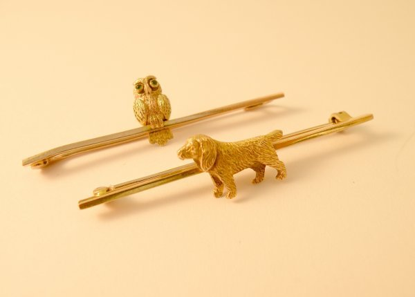 12C: Two bar brooches, to include; a 9ct yellow gold sp