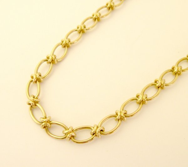 16C: A 9ct yellow gold decorative link chain, the unifo