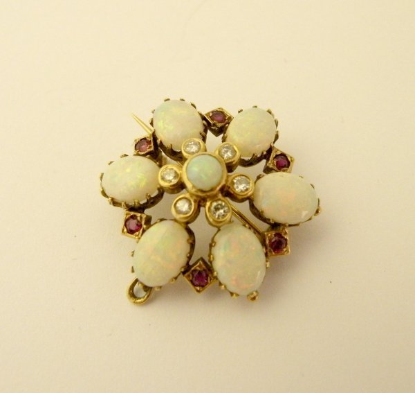 24C: An opal, ruby and diamond brooch/pendant, designed