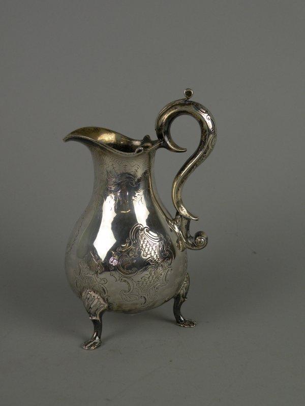 264C: A Dutch silver milk jug, 18th century, the balust
