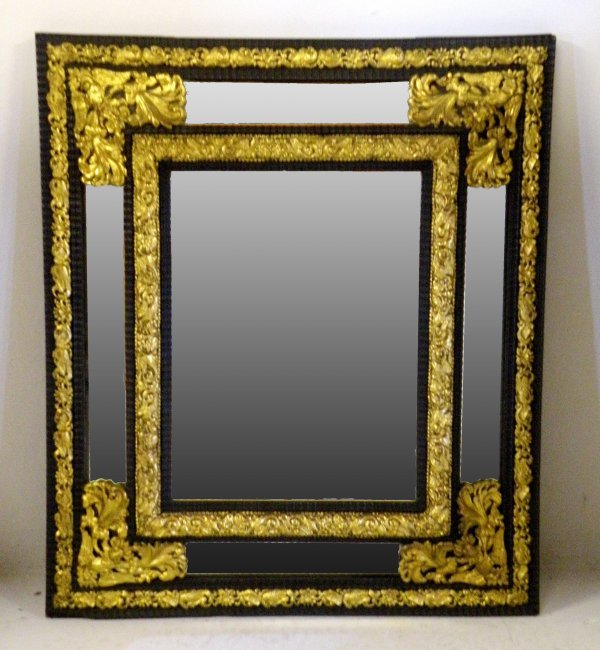 23D: An Italian repouse wall mirror, 19th century, the