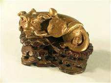 9: A Chinese miniature brass Kylin, probably Ming