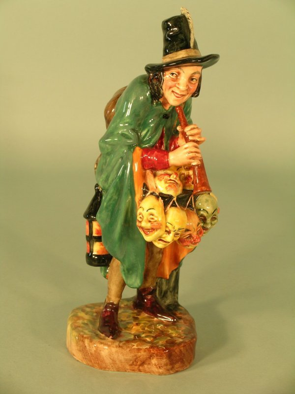 12C: A Royal Doulton figure of the Mask Seller HN2103,