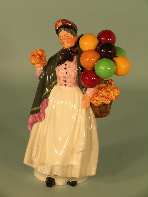 15C: A Royal Doulton figure of Biddy Penny Farthing HN1