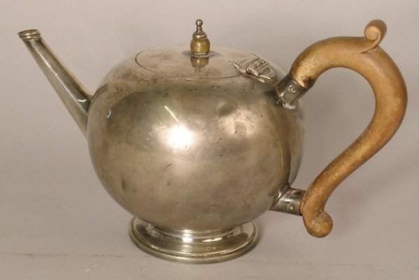 23B: A silver teapot of ball form, London 1909,